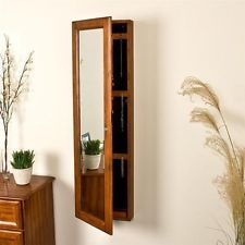 Decorative Wall Mounted Jewelry Armoire Locking Cabinet Wood with Mirror Brown Finish Perfect for the bedroom or bathroom decor