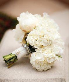Gorgeous white hydrangea wedding bouquet - via Mod Wedding
