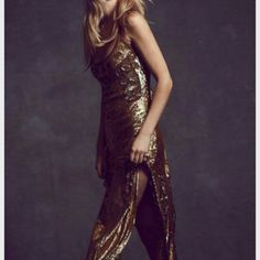 Free People sequin MILLION DOLLAR MAXI Free People Million Dollar Maxi  BRAND NEW WITH TAGS!  The moment you slip into this gown, you?ll be draped in liquid gold. Allover sequin maxi dress with a strappy dipped back and elegant side slits. Mesh inserts with gold beading and cloudy crystal sequins. Lined.   *By Free People    *100% Nylon  *Hand Wash Cold  *Import  Measurements for Small: Bust: 33 in = 83 3/4 cm  Waist: 30 in = 76 1/4 cm  Hips: 37 in = 94 cm  Length: 52 in = 132 cm  NOT SURE…