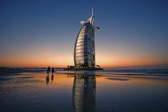 Burj Al Arab Hotel reflected on beach at sunset, Dubai, United Arab Emirates (UAE) Places Around The World, In This World, Around The Worlds, Cool Places To Visit, Places To Travel, Visit Dubai, Dubai Uae, Burj Al Arab, United Arab Emirates
