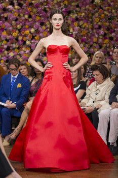 Runway models wear Raf Simons designs at the 2012 Fall Christian Dior that he designed under the Christian Dior label .
