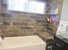 """Our latest bathroom install.  Tile bathtub surround. """"Slate"""" porcelain from lowes. Chair rail. Blue. Upcycled vanity with frosted vessel sink."""