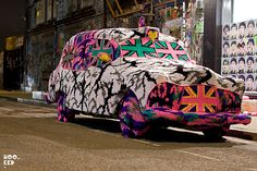 Yarn bombing American based Polish artist Olek covers a London Black Cab in yarn.