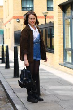 We can't get enough of Louisa's distressed denim look. If everyone starts wearing dungarees much more relaxed like this then I never want them to go out of style again. #blackballad #streetstyle #fashion #dungarees #denim #backpack