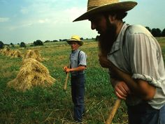 FATHER AND SON WORK IN THE FIELD TOGETHER