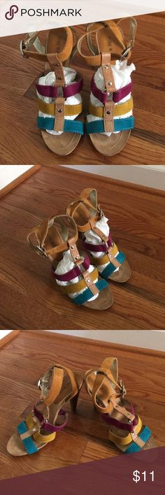 """Nine West Multicolored Sandal  Pre-owned but good condition multicolor Nine West sandal.  Heel is 4"""" with beautiful colors to include Purple/Gold/Turquoise.  Has plenty of wear/life left.  Smoke-free, pet-free home. Nine West Shoes Sandals"""