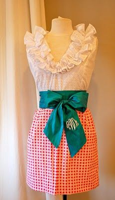 Love the dress, the bow, the ruffled neckline, the monogram...