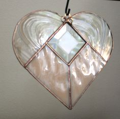 Stained glass heart Pink champagne baroque swirl waterglass 6 inch Clear bevel suncatcher.. $32.00, via Etsy.