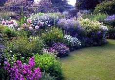 country garden - SFH adds: I had to pin this wonderful site on three different boards it is such a great example of a successful border, winning plant combinations, and Blue/Purple- crown jewels in the garden.