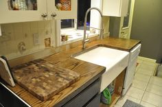 DIY Countertops using construction grade wood doors - under $100 for the entire kitchen! Instructions at source