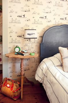 Kirsten Marchand's home, Rocks Village, Massachusetts: Duvet handmade with fabric from ABC Home & Carpet, wallpaper from OhHoy, Fine Little Day, lampshade is ReGo LLC, Voz Art bracelet. Headboard painted in Benjamin Moore Polo Blue, trim paint is BM November Rain.