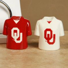 Oklahoma Sooners Gameday Salt and Pepper Shakers by The Memory Company. $15.95. NCAA licensed. Hand painted. Approximately 3 inches tall by 2.5 inches wide. Bring some team spirit to the table with these adorable ceramic salt and pepper shakers! The Oklahoma Sooners Gameday salt and pepper shakers are perfect whether you're tailgating or having some friends over to watch the big game. Each shaker is hand painted in vivid colors and clearly labeled salt and pepper...