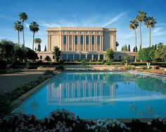 Mesa, Arizona LDS temple is enhanced by the image in the reflecting pool in the foreground. Dedicated 26 October 1927 by President, Heber J. Grant. The exterior of the temple is faced with glazed egg-shell colored terra cotta tiles.