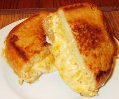 The Ultimate Grilled Cheese Sandwich ~ WOW!  If you love a rich, gooey grilled cheese sandwich, this is it!  Ingredients include cream cheese, cheddar cheese, mozzarella cheese, garlic powder, seasoning salt, cracked black pepper, mayo & Texas toast! 1⁄2 cup butter, softened, more if neededounces cream cheese, softened 1⁄2 cup mayonnaise 2 cups cheddar cheese, shredded 2 cups mozzarella cheese, shredded 1⁄2 teaspoon garlic powder 1⁄2 teaspoon seasoning salt 1⁄4 teaspoon cracked black pepper…