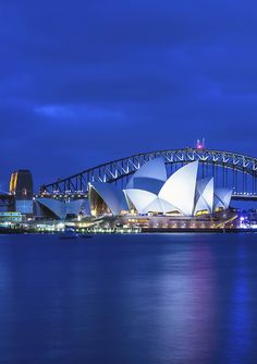 See the Sydney Opera House lit up at night as part of a 10-day tour of Australia and New Zealand. Book through Groupon to find travel packages that include airfare #GrouponGetaways