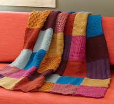 This Granny Square Tunisian Throw will look great draped over your family room sofa and will definitely add a pop of color to any room of your home. The tunisian crochet stitch is used to complete this free crochet afghan pattern.