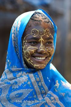 **Girl with traditionally painted face from the Sakalava tribe, Nosy Be, Madagascar