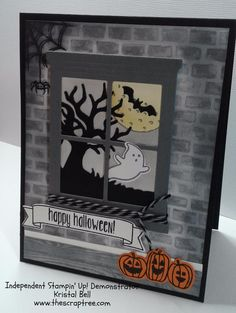 This handmade Halloween card has it all:  haunted house brick wall, spider and web, bat flying in the full moon, ghost and creepy tree, and a trio of smiling Jack-o-lanterns.