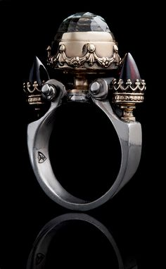 William Llewellyn Griffiths. Ring: Quartz Urn, 2010. 9ct yellow gold and silver, quartz, garnet.