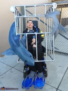 Tara: My son Christopher is a scuba diver in a shark tankWe are always looking for new & creative ideas to dress up his wheelchair so I find other costumes online...