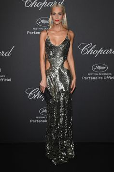 16 May Poppy Delevingne wore a cut-out metallic gown with a Swarovski clutch to the jewellery event. - HarpersBAZAAR.co.uk