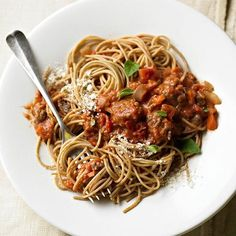 This Spaghetti with Best-Ever Bolognese Sauce features a blend of beef, veggies, and warm garlic-tomato sauce. More ways to cook ground beef: http://www.bhg.com/recipes/beef/ground-beef-recipe-ideas/ #myplate #protein #grain