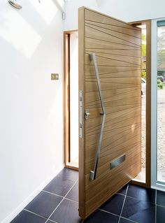 Pale wooden pivot door from Urban Front