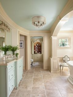 Soothing, spa-like colors: Creamy walls (SW Moderate White), darker trim (SW Macadamia), blue ceiling (BM Palladian Blue/SW Meander Blue). Photo via Houzz.