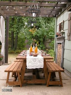 This DIY patio design with pergola features a rustic and repurposed touches with a harvest table, faux fireplace, and curtains for privacy. All completed by one couple on a budget by Prodigal Pieces www. Rustic Pergola, Outdoor Pergola, Outdoor Rooms, Outdoor Dining, Outdoor Furniture, Outdoor Decor, Pergola Ideas, Pergola Kits, Outdoor Seating