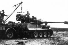 Repair work on the replacing the Maybach HL 210 engine on this Tiger 1 Ausf E operating with the 1st Company of the 501st Heavy Tank Battalion Wehrmacht (s.Pz.Abt.501).