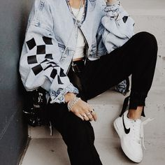 Bold denim jacket, black incorporated pieces. Nike sneakers with black jeans.