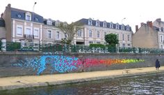 Origami installations by Mademoiselle Maurice.  In late May, French artist Mademoiselle Maurice created three colorful origami installations in Angers, France for the ARTAQ 2013 festival. The large-scale outdoor installations were made from 30,000 pieces of origami made by the people of Angers in the months before the festival.