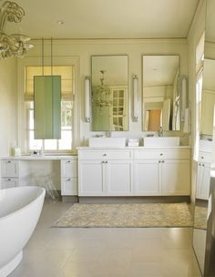 Lucite furnishings mix with a contemporary Victoria & Albert tub to strike the delicate balance between traditional glam and modern minimalism.
