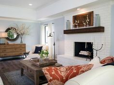 HGTV: The brick fireplace was painted bright white, a new mantle was installed, and the fireplace doors were removed for a more modern look.