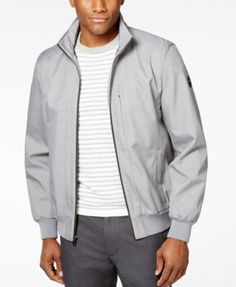 MICHAEL Michael Kors Men's Heather Soft-Shell Bomber Jacket $69.98 Refine your cool-weather, casual style with this heather bomber jacket from MICHAEL Michael Kors, featuring a handsome fit crafted from lightweight fabric, a comfortable stand collar and a warm, fully-lined interior.