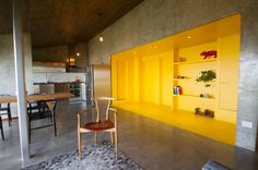 A mostly neutral, industrial apartment in the mountains of Northeastern Mexico packs a bold and unexpected punch.