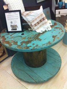 Table made from old cable spool. Wheels added to base so it will roll wherever it's needed.