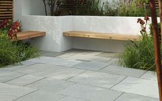 Contemporary hardwood benches built into a white rendered, walled seating/patio area Stonemarket: Garden range: Natural Stone: Trustone Fellstyle Concrete Garden Bench, Garden Paving, Garden Benches, Built In Garden Seating, Paving Stone Patio, Slate Paving, Bluestone Pavers, Stone Walkways, Wood Benches