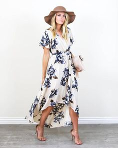 Spring vibes have arrived and our Blue Bonnet Maxi Dress is perfection! A cream hued faux wrap dress with blue and brown florals. This soft and vintage inspired dress features a fitted elastic waist a