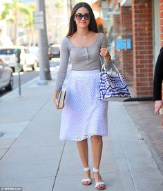 Emmy Rossum wearing Ella Moss Tessa Pleat Eyelet Skirt and Yosi Samra Cambelle Sandals in Biscotti and White