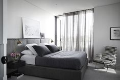 Renovation: the overhaul of an art-loving, empty-nesters Melbourne apartment: The bedroom is almost exclusively black, grey and white, with sheer curtains to let in natural light to the smalll space. Modern Headboard, Headboards For Beds, Headboard Ideas, Bedroom Ideas, Neutral Curtains, Sheer Curtains, Melbourne Apartment, Penthouse Apartment, Interior Minimalista
