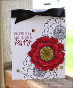 Love how the colored flower pops off the card!