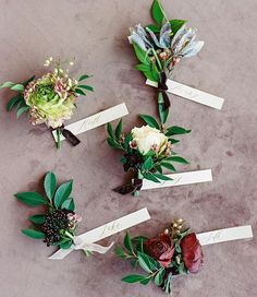 These mismatched boutonnieres were tied with velvet ribbons and personalized with hand-lettered tags. #marthaweddings : @imryanray | : @stefaniemiles | : @bowsandarrowsflowers | : @writtenwordcalligraphy