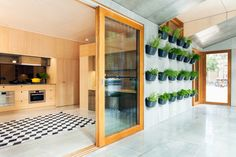Australia's first carbon-positive prefab house. Nice way to have a fresh herbs close to the kitchen.