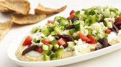 70% less fat • 54% fewer calories • 48% less sodium than the original recipe. You'll love this much better-for-you appetizer updated with fat-free ingredients, extra veggies and baked whole wheat pita chips.