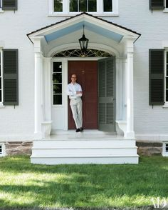 Decorator Bruce Shostak stands at the front door of Hillstead, the Federal-era…