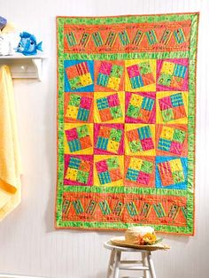 """Have some summer fun stitching this summery beach blanket. This e-pattern was originally published in the August 2005 issue of Quilter's World magazine.Size: 40"""" x 62"""". Skill Level: Beginner"""