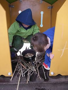 Adding loose parts to the fixed equipment...camp fire with sticks and a pot!