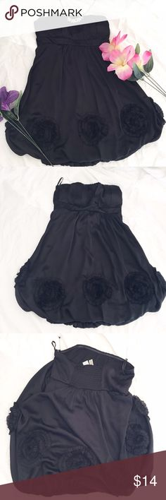 Black Slinky Rosette Bubble Dress Silly textured bubble dress has a large floral rosettes at the bottom and strapless chest.   100% polyester/dry clean                                        >>measurements<< -bust:15 in -waist:15.5 in  -length:27 in    >>Condition:pre-loved no major damage  No holds or Trades sorry! Aggie Dresses Strapless