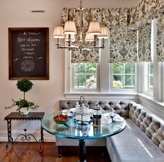 modern banquette seating in Dining room | Image via Kim E. Courtney Interiors .
